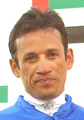 Jockey David Flores rallied in the stretch with #6 Embroiled