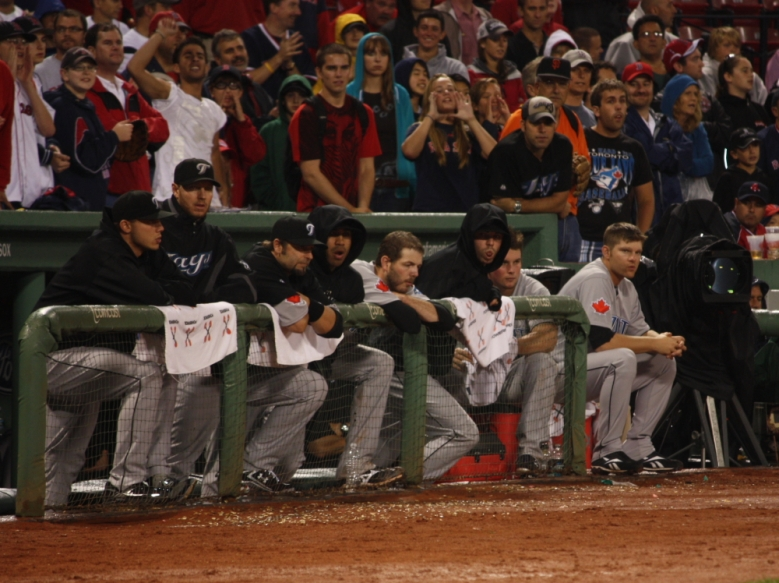 Boston fans seated behind the Blue Jays dugout shout 9th-inning encouragement to the Sox