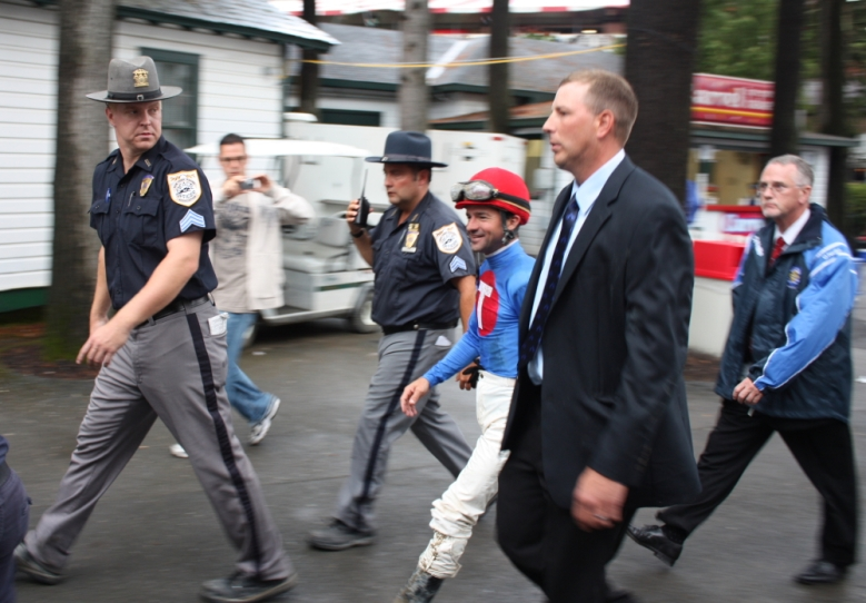 Desormeaux gets a police escort from the track through the crowd to the jockeys room