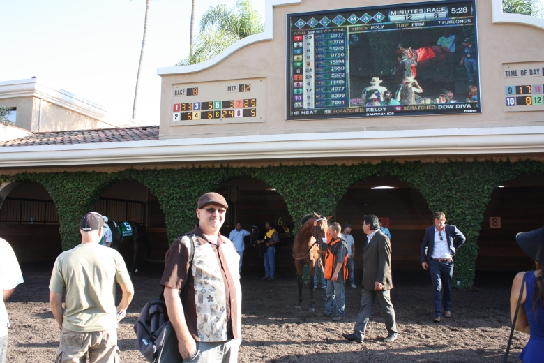 Fresh off the plane from Boston, Ed Collins eyeballs the paddock prospects before the $300,000 Del Mar Futurity on Sept. 4.
